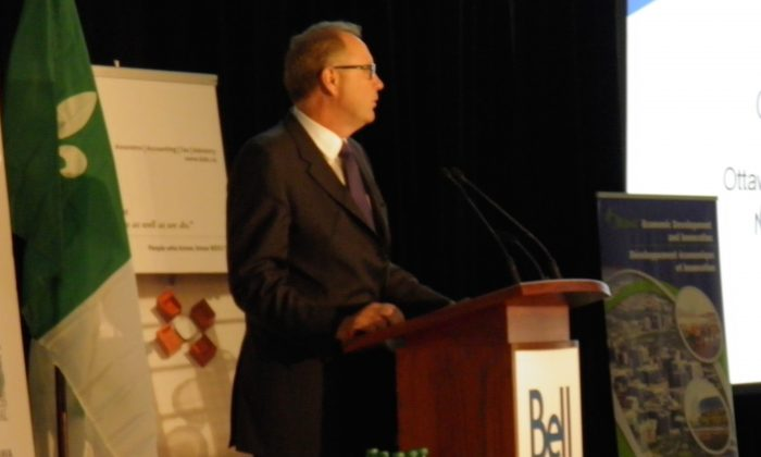 George Cope, president and CEO of Bell Canada, speaks to local business leaders in Ottawa on Nov. 12, 2014 (Epoch Times)