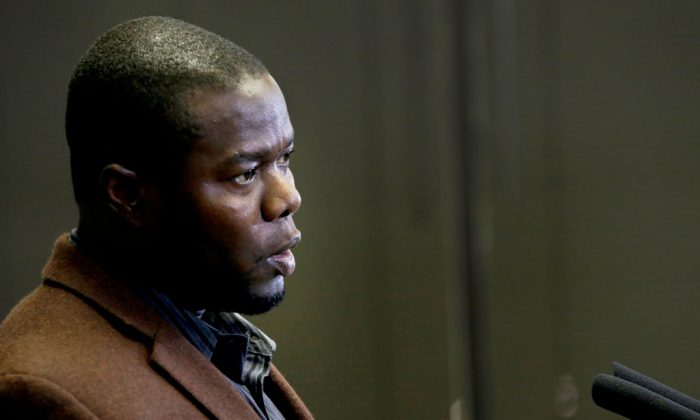 Josephus Weeks, nephew of Thomas Eric Duncan, speaks during a news conference in Dallas, Wednesday, Nov. 12, 2014. The hospital that treated Duncan, the only Ebola patient to die in the United States, will pay his relatives an undisclosed sum and create a charitable foundation in his name, the family's attorney said Wednesday. (AP Photo/LM Otero)