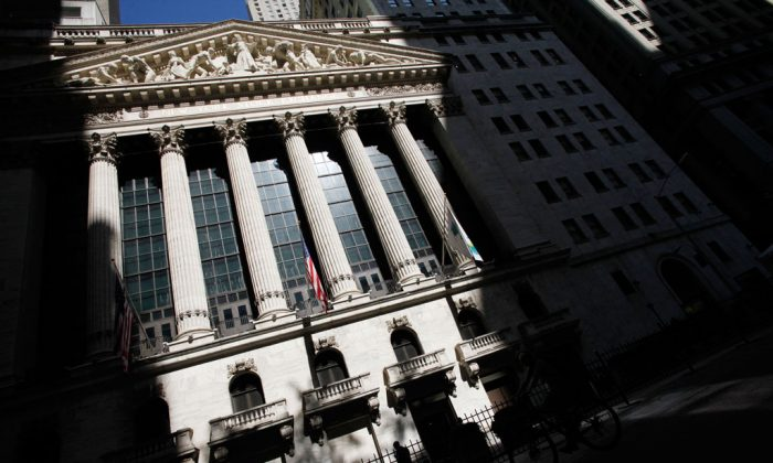 The New York Stock Exchange in New York on July 15, 2013. Big banks led the market lower in early trading Wednesday, Nov. 12, 2014, pulling indexes down from record highs. Regulators in the US and Europe fined five major banks more than $3.4 billion for manipulating foreign-currency trading. (AP Photo/Mark Lennihan)