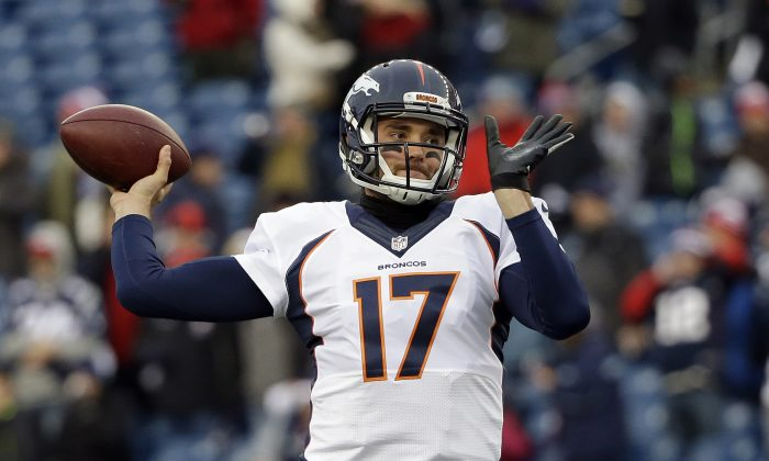 FILE - In a Nov. 2, 2014, file photo Denver Broncos quarterback Brock Osweiler warms up before an NFL football game against the New England Patriots in Foxborough, Mass.  Osweiler has waited patiently as Peyton Manning's backup for 2 ½ years.   He was disappointed on Sunday, Nov. 9, 2014, when he was all warmed up and ready to go in the game only to see the five-time MVP trot back onto the field. (AP Photo/Steven Senne)