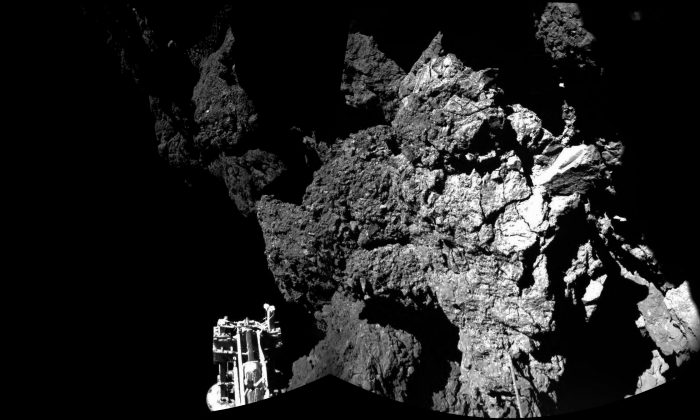 The combination photo of different images taken with the CIVA camera system released by the European Space Agency ESA on Thursday Nov. 13, 2014, shows Rosetta's lander Philae as it is safely on the surface of Comet 67P/Churyumov-Gerasimenko, as these first CIVA images confirm. One of the lander's three feet can be seen in the foreground. Philae became the first spacecraft to land on a comet when it touched down Wednesday on the comet, 67P/Churyumov-Gerasimenko. (AP Photo/Esa/Rosetta/Philae)