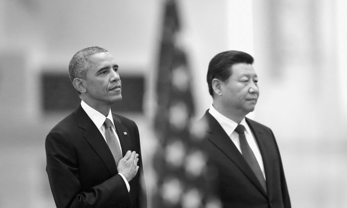 US President Barack Obama (L) and Chinese Communist Party leader Xi Jinping listen to the US national anthem during a welcoming ceremony inside the Great Hall of the People on Nov. 12, 2014, in Beijing, China. Obama paid a state visit to China after attending the 22nd Asia-Pacific Economic Cooperation (APEC) Economic Leaders' Meeting in Beijing. (Feng Li/Getty Images)