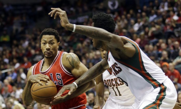 "An article saying Derrick Rose retired at age 26 due to ""to a recent eczema diagnosis"" is satire. Chicago Bulls' Derrick Rose tries to drive past Milwaukee Bucks' Larry Sanders during the first half of an NBA basketball game Wednesday, Nov. 5, 2014, in Milwaukee. (AP Photo/Morry Gash)"