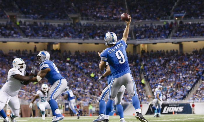 Detroit Lions quarterback Matthew Stafford (9) passes the ball against the Miami Dolphins during an NFL football game at Ford Field in Detroit, Sunday, Nov. 9, 2014. (AP Photo/Rick Osentoski)