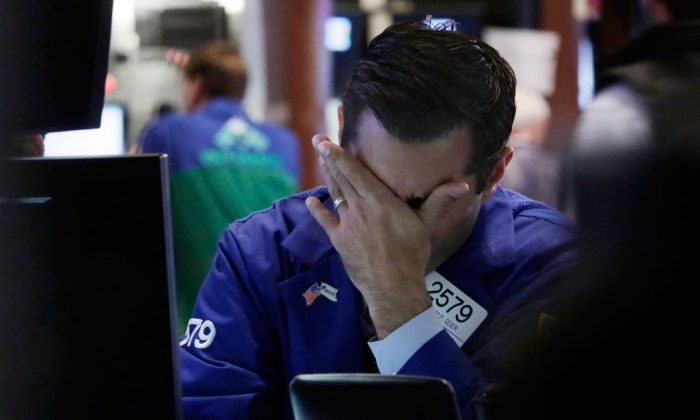 Specialist William Geer works at a post on the floor of the New York Stock Exchange on Oct. 16, 2014. (AP Photo/Richard Drew)