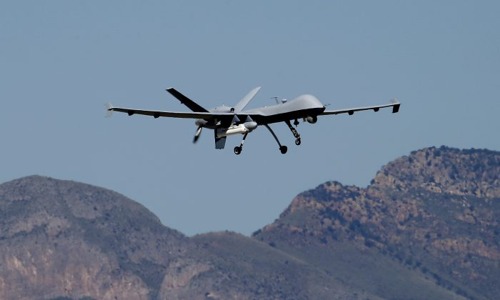 A U.S. Customs and Border Patrol drone aircraft lifts off, Wednesday, Sept 24, 2014 at Ft. Huachuca in Sierra Vista, Ariz. (AP Photo/Matt York)