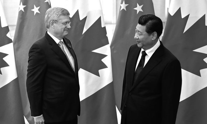 Prime Minister Stephen Harper chats with Chinese President Xi Jinping during a meeting at the Great Hall of the People on Nov. 9 in Beijing. (Petar Kujundzic/Pool/Getty Images)
