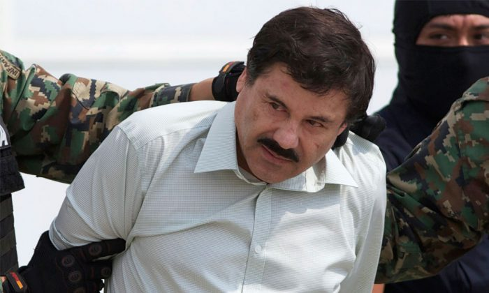"Joaquin ""El Chapo"" Guzman, the head of Mexico's Sinaloa Cartel, being escorted to a helicopter in Mexico City following his capture overnight in the beach resort town of Mazatlan, on Feb. 22, 2014. (AP Photo/Eduardo Verdugo)"