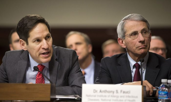 Centers for Disease Control and Prevention Director Dr. Thomas Frieden (L) accompanied by National Institute of Allergy and Infectious Diseases Director Anthony Fauci, testifies on Capitol Hill in Washington, Wednesday, Nov. 12, 2014, before the Senate Appropriations Committee hearing on the government's Ebola response (AP Photo/Jacquelyn Martin)