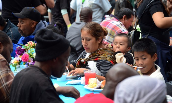 Homeless people eat a meal hosted by the LA Mission in Los Angeles on April 18, 2014. (Frederic J. Brown/AFP/Getty Images)