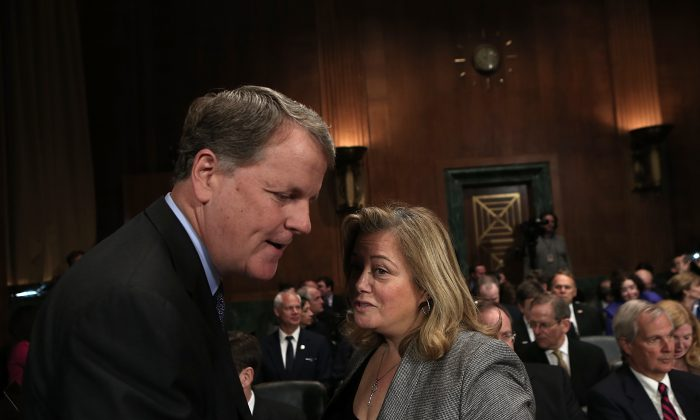 Douglas Parker (L), chairman and CEO of the US Airways Group, speaks with lobbyist Hillary Rosen before a hearing of the Senate Judiciary Committee in Washington, D.C., on March 19, 2013. Parker and Horton testified before the committee on the topic of The American Airlines/US Airways Merger: Consolidation, Competition, and Consumers. (Win McNamee/Getty Images)