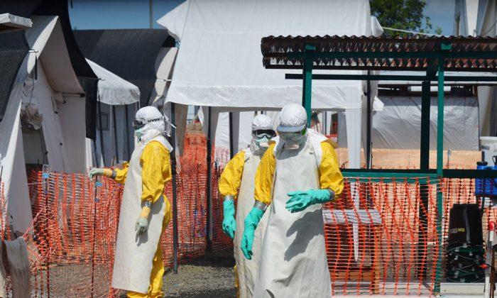 Health workers at a clinic run by the non-governmental organization Doctors Without Borders in Monrovia, Liberia, on Nov. 1, 2014. (Zoom Dosso/AFP/Getty Images)