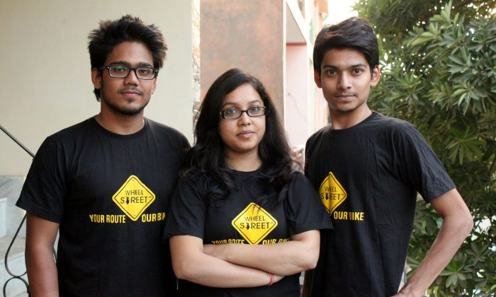 Mritunjaya Kumar (L), Moksha Shrivastav (C), and Pranay Shrivastav (R) the core team of Wheelstreet.in, India's first bike rental portal, outside their office in Noida City on Nov. 2, 2014. (Venus Upadhayaya/Epoch Times)