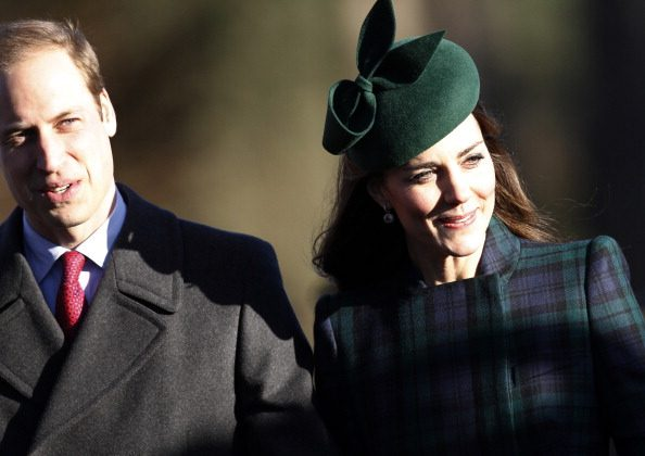 Britain's Prince William (L) and his wife Catherine, Duchess of Cambridge, arrive for a traditional Christmas Day Church Service at Sandringham in eastern England, on December 25, 2013. AFP PHOTO / ADRIAN DENNIS (Photo credit should read ADRIAN DENNIS/AFP/Getty Images)