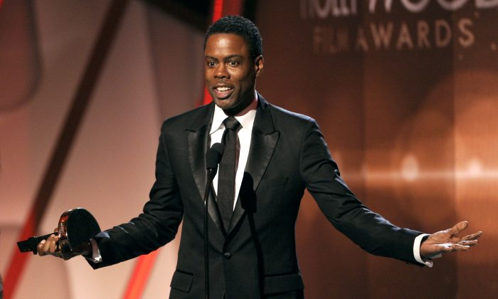 Chris Rock in a file photo (Photo by Chris Pizzello/Invision/AP)