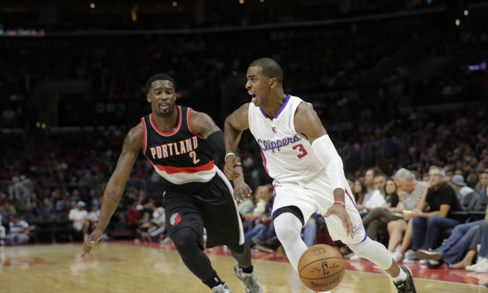 Los Angeles Clippers' Chris Paul, right, drives past Portland Trail Blazers' Wesley Matthews during the first half of an NBA basketball game Saturday, Nov. 8, 2014, in Los Angeles. (AP Photo/Jae C. Hong)