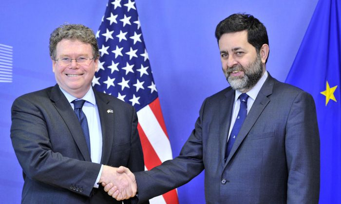 EU chief negotiator Ignacio Garcia Bercero (R) and US chief negotiator Dan Mullaney (L) pose on March 10 at EU Headquarters in Brussels before the most recent round of EU-US trade talks. (Georges Gobet/AFP/Getty Images)