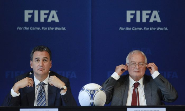 Michael J Garcia (L), Chairman of the investigatory chamber of the FIFA Ethics Committee, and Hans-Joachim Eckert (R), Chairman of the adjudicatory chamber of the FIFA Ethics Committee, gesture during a press conference at the FIFA's headquarter on July 27, 2012, in Zurich. (Sebastien Bozon/AFP/Getty Images)