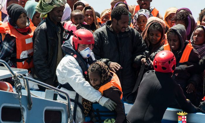 Italian Navy rescuing illegal migrants under 'Mare Nostrum' mission. On November 10, President of Italian Chamber of Deputies, Laura Boldrini, expressed her concerns about the European program 'Frontex.' (marina.difesa.it)
