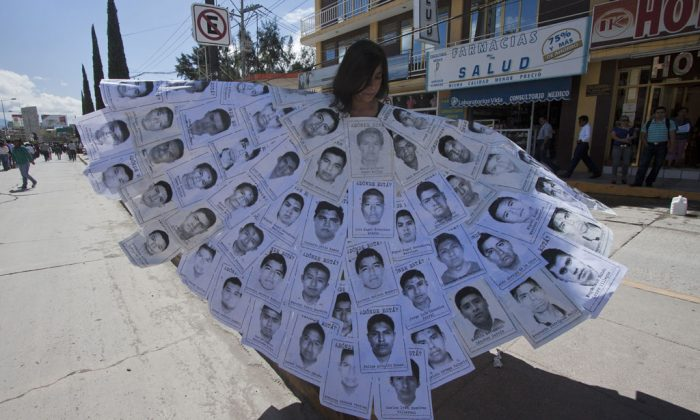 People take part in a protest in Chilpancingo, Guerrero State, Mexico, on Nov. 14, 2014, to demand the safe return of 43 students who went missing in southern Mexico after an attack by gang-linked police last Sept. 26. Rocked by the massacre of 43 students who disappeared in late Sept., Mexico has appointed a new head of human rights to the lead the violence-plagued country's abuse-investigating body. (Hector Guerrero/AFP/Getty Images)