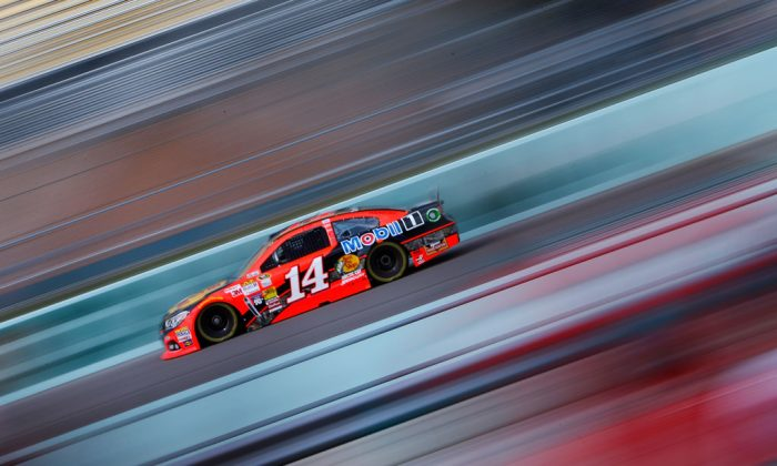 Tony Stewart, driver of the #14 Bass Pro Shops/Mobil 1 Chevrolet, practices for the NASCAR Sprint Cup Series Ford EcoBoost 400 at Homestead-Miami Speedway on Nov. 15, 2014, in Homestead, Florida. (Jonathan Ferrey/Getty Images)