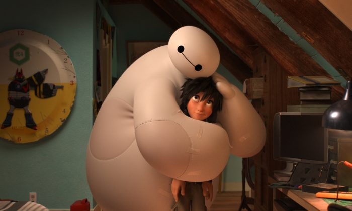 "Baymax, voiced by Scott Adsit, gives Hiro Hamada, voiced by Ryan Potter, a hug in ""Big Hero 6."" (AP Photo/Disney)"