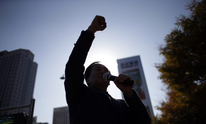 North Korean defector Kim Seong-Min, the head of Free North Korea Radio, shouts slogans during a rally to improve human rights condition in North Korea, in Seoul, South Korea, on Nov. 14, 2014. Kim has worked to help North Koreans bolster their reports by smuggling in illegal cellphones and camcorders for them.(AP Photo/Lee Jin-man)