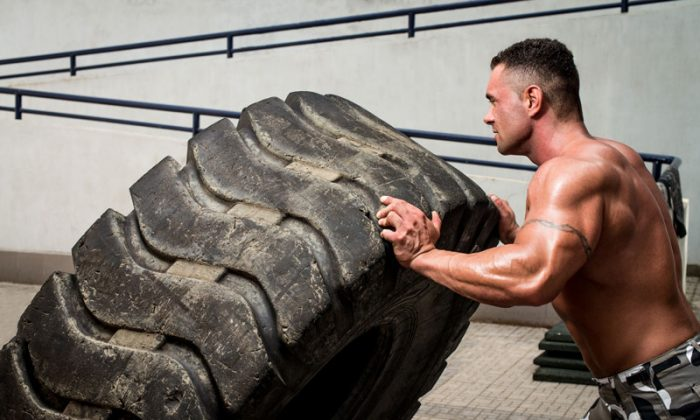 CrossFitters can be found flipping tires or hitting them with a sledgehammer, climbing ropes, and tossing medicine balls. (Shutterstock*)