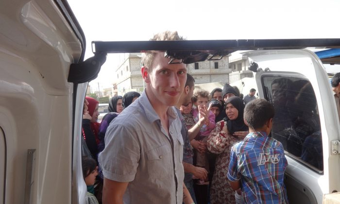 Peter Kassig delivering supplies for Syrian refugees. A new graphic video purportedly produced by Islamic State militants in Syria released on Sunday, Nov. 16, 2014, claims US aid worker Kassig was beheaded. (AP Photo/Courtesy of Kassig Family)
