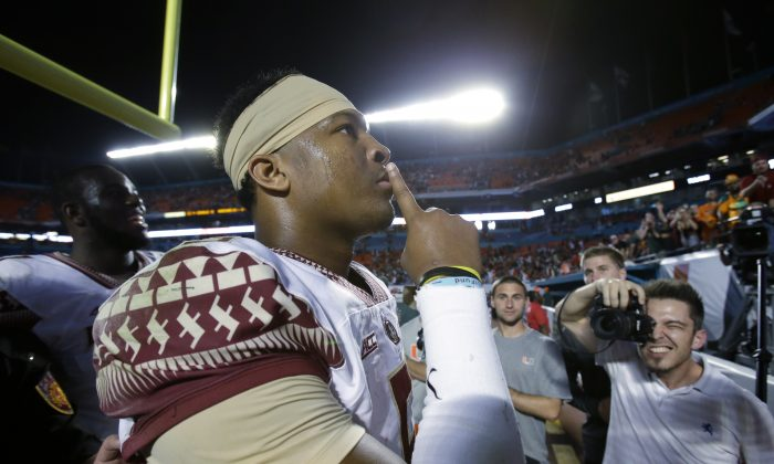Florida State quarterback Jameis Winston gestures to the crowd after Florida State defeated Miami 30-26 in an NCAA College football game, Saturday, Nov. 15, 2014 in Miami Gardens, Fla. (AP Photo/Wilfredo Lee)