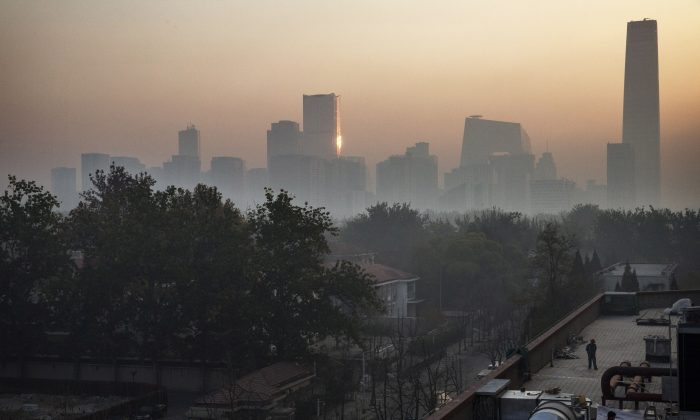 Smog covers the skyline in Beijing on Nov. 16, 2014. (Kevin Frayer/Getty Images)