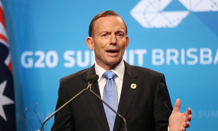Australia's Prime Minister Tony Abbott speaks to the media during a press conference at the conclusion of the G-20 summit in Brisbane, Australia, Sunday, Nov. 16, 2014. (AP Photo/Rob Griffith)