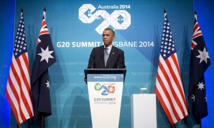 U.S. President Barack Obama pauses during his news conference at the G20 Summit in Brisbane, Australia, Sunday, Nov. 16, 2014. (AP Photo/Pablo Martinez Monsivais)
