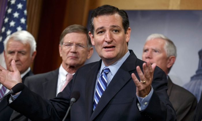Sen. Ted Cruz (R-Texas) criticizes President Barack Obama, saying he has not taking a stand on the immigration crisis on the US-Mexico border and is putting off executive action until after the politically-charged midterm election in November, on Sept. 9, 2014. (AP Photo/J. Scott Applewhite)