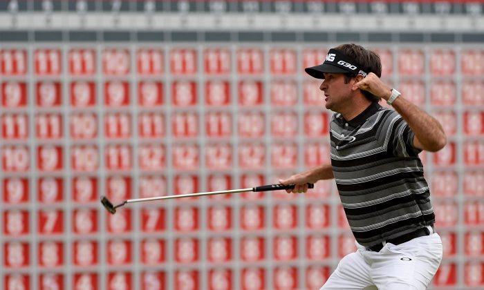Bubba Watson of the USA celebrates his birdie putt and victory on the first play-off hole during the final round of the WGC - HSBC Champions at the Sheshan International Golf Club on November 9, 2014 in Shanghai, China. (Ross Kinnaird/Getty Images)