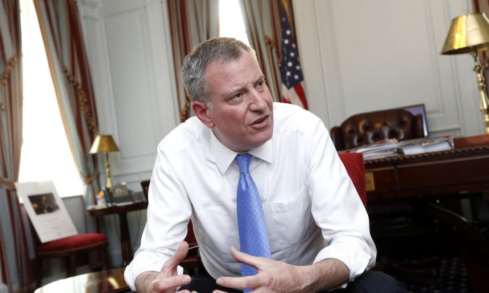 New York Mayor Bill de Blasio at City Hall in New York City on April 9, 2014. DeBlasio's plan for affordable housing was updated at a City Council hearing on Monday, November 17, 2014. (AP Photo/Jason DeCrow)