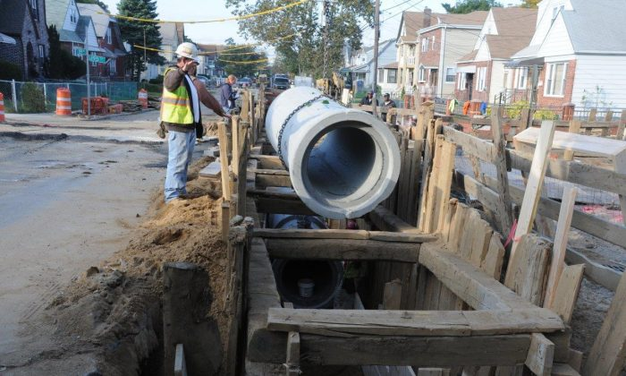 Workers install new water main pipe in the Queens neighborhood of Laurelton in New York City. Eighteen million dollars was pledged Monday by New York City's Department of Environmental Protection for expanded water management. (Courtesy of NYC Environmental Protection)