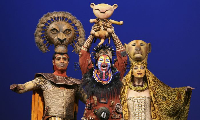 "(L–R) Nathaniel Stampley as Mufasa, Tshidi Manye as Rafiki, and Jean Michelle Grier as Sarabi, in Disney's ""The Lion King"" in New York. Disney Theatrical Productions is letting ticketholders to its Broadway shows— ""Aladdin"" and ""The Lion King""—the chance to switch the dates they see the musicals for any reason as long as it's done two hours before the performance. (AP Photo/Disney Theatrical Group, Joan Marcus)"
