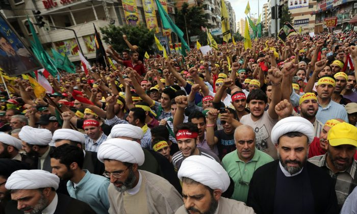 Shiite Muslim clerics and supporters of Lebanon's Hezbollah group march during a rally in southern Beirut to denounce a film mocking Islam on Sept. 17, 2012. (Joseph Eid/AFP/GettyImages)