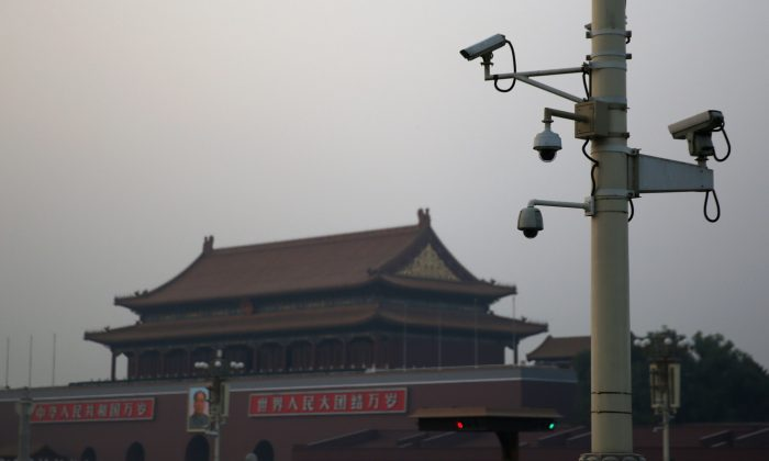 "Security cameras in front of the Tiananmen Gate on November 8, 2013 in Beijing, China. Because of the US$3.26 billion program ""Big Intelligence,"" cameras like these are ubiquitous in China's big cities. (Feng Li/Getty Images)"