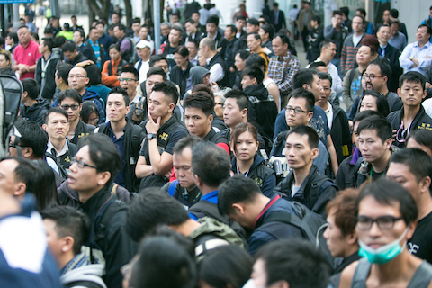 The anti-Triad police stand by as protest leaders speak to students about leaving the area around the CITIC Tower at the Admiralty protest site in Hong Kong on Nov. 18, 2014. (Benjamin Chasteen/Epoch Times)