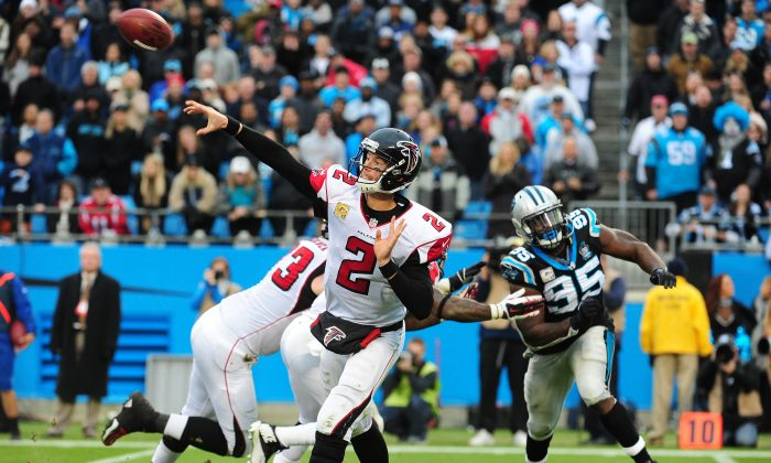 Matt Ryan of the Atlanta Falcons throws a pass against the Carolina Panthers at Bank Of America Stadium on Nov. 16, 2014 in Charlotte, North Carolina. The Falcons picked up a crucial win to take first place in the NFC South. (Scott Cunningham/Getty Images)
