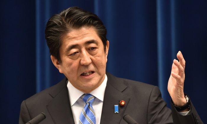 Japan's Prime Minister Shinzo Abe speaks during a press conference at his official residence in Tokyo on Nov. 18, 2014. Abe said November 18 he was delaying an expected sales tax rise and dissolving the lower house of parliament after figures showed Japan was in a recession. (Kazuhiro Nogi/AFP/Getty Images)