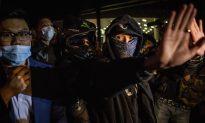 Hong Kong: Radical Protesters Smash Glass Door of Legislature