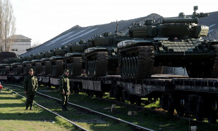 Russian soldiers stand near a trainload of their modified T-72 tanks after their arrival in Gvardeyskoe railway station near the Crimean capital Simferopol, on March 31, 2014. (Olga Maltseva/AFP/Getty Images)