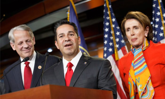 Rep. Ben Ray Lujan (D-N.M.) (C) flanked by Nancy Pelosi (D-Calif.) (R) and Rep. Steve Israel (D-N.Y.) (L), during a news conference at the Capitol in Washington on Nov. 17, 2014. (AP Photo)