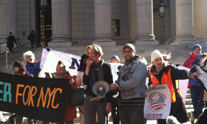 Former New York gubernatorial candidate Zephyr Teachout (L) and filmmaker Josh Fox at a rally protesting the Keystone XL Pipeline in downtown Manhattan, New York on Tuesday, Nov. 18, 2014. On Tuesday evening, the U.S. Senate was expected to vote on whether to approve the next phase of the pipeline's construction, which will bring crude oil from Canadian tar sands to refineries along the U.S. Gulf Coast. (Annie Wu/Epoch Times)