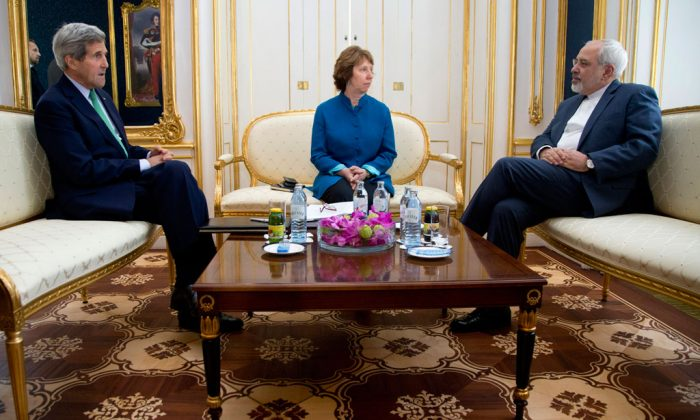 (L-R) US Secretary of State John Kerry, European Union High Representative Catherine Ashton, and Iranian Foreign Minister Mohammad Javad Zarif are photographed as they participate in a trilateral meeting in Vienna, Austria, on Oct. 15, 2014. Iran and six world powers are closer than ever to a deal that would crimp Tehran's ability to make nuclear arms - a status that would lead to a progressive end to sanctions on the Islamic Republic and ease tensions that could boil over into a new Middle East war. The bad news? Substantial differences remain. (AP Photo/Carolyn Kaster)