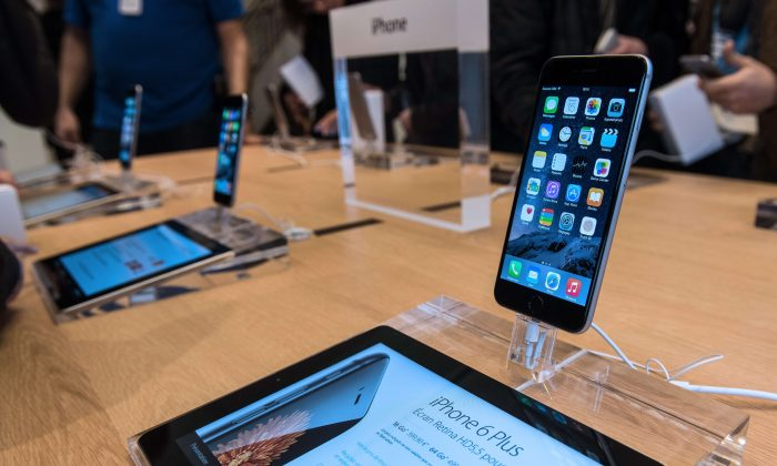 A picture taken on Nov. 15, 2014 in Lille, shows an iPhone displayed in the new Apple store, the day of its opening. (Denis Charlet /AFP/Getty Images)