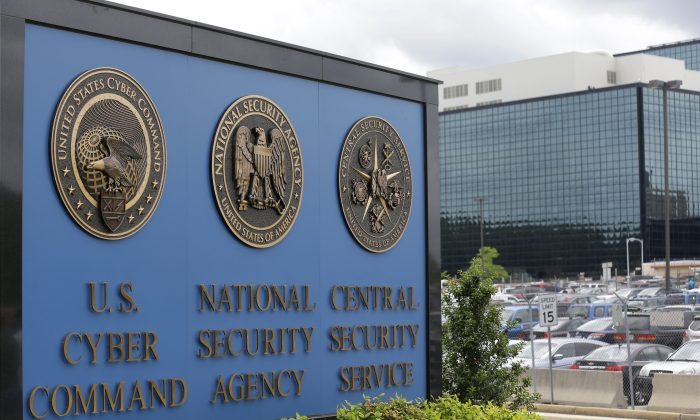 FILE - In this June 6, 2013 file photo, a sign stands outside the National Security Agency (NSA) campus in Fort Meade, Md. Years before Edward Snowden sparked a public outcry with the disclosure that the NSA had been secretly collecting American telephone records, some NSA executives voiced strong objections to the program, intelligence officials say, complaining that it exceeded the agency's mandate to focus on foreign spying and would do little to stop terror plots.(AP Photo/Patrick Semansky, File)